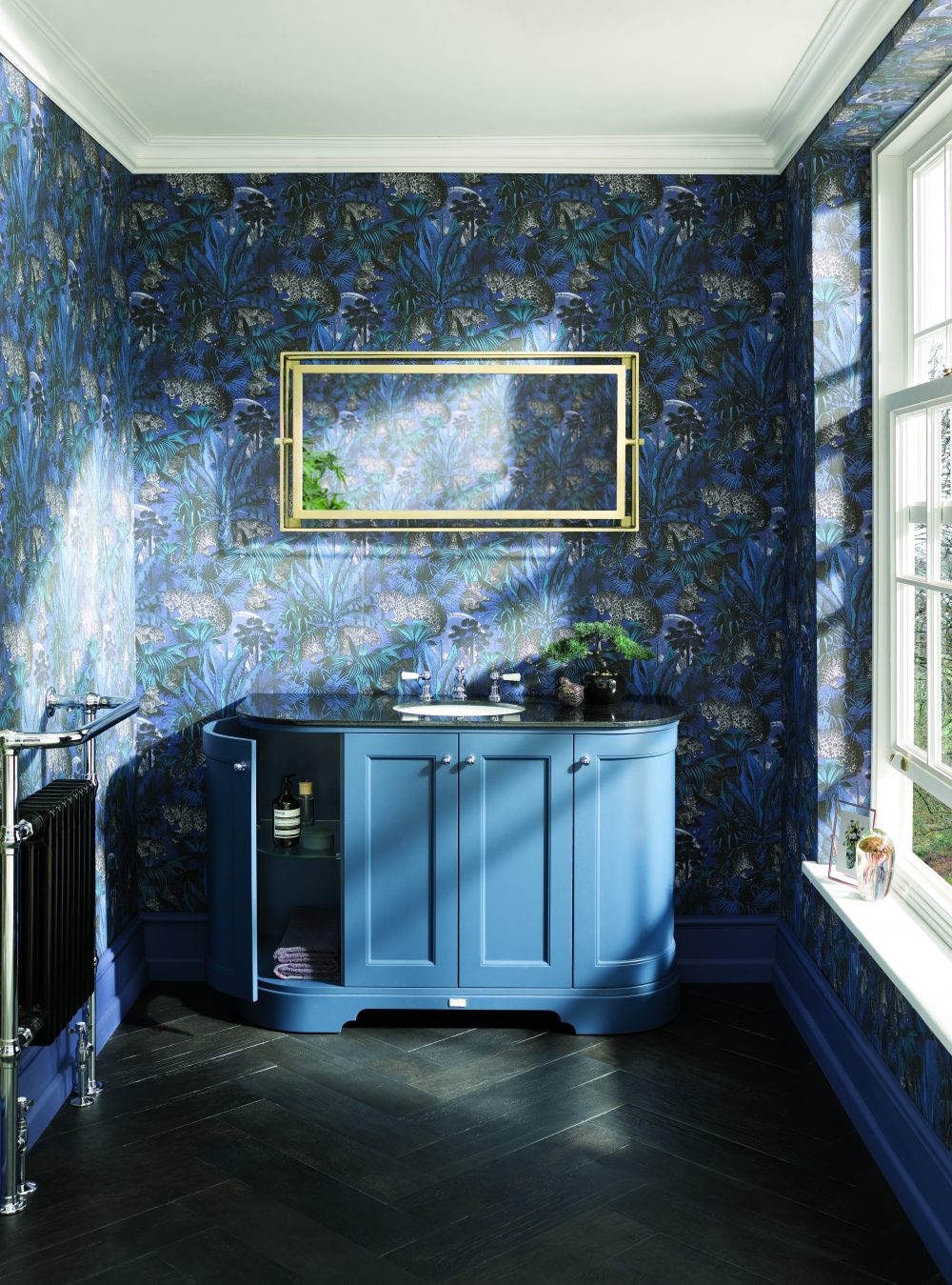 The Open Stiffkey Blue 1200 Curved Unit with Black Top with Divine Savages Wallpaper - Nocturnal Faunacation