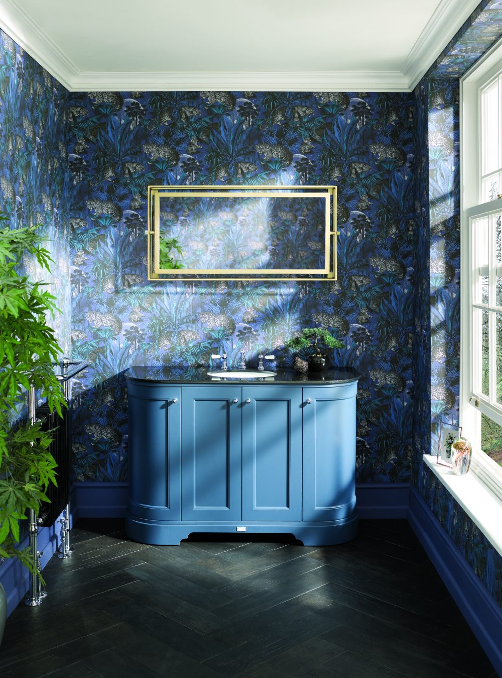 The Stiffkey Blue 1200 Curved Unit with Black Top with Divine Savages Wallpaper - Nocturnal Faunacation